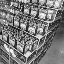 stacks of great lakes brewing company's 6-packs on display