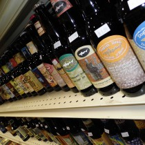 a few dogfishhead bottles of beer on shelf