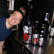 Dave next to bottles of Stone Brewery's Double Bastard