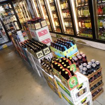 stacks of beers in the aisle in front of the beer coolers